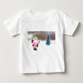 Model of Santa Claus standing in white snow Baby T-Shirt