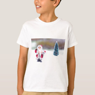 Model of Santa Claus standing in white snow T-Shirt