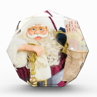 Model of Santa Claus with bell gifts and money