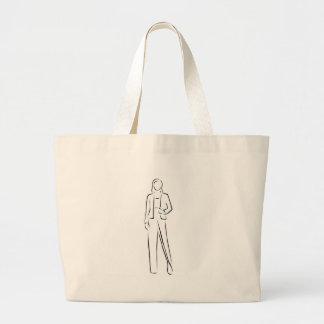 Model on a runway in designer outfit large tote bag