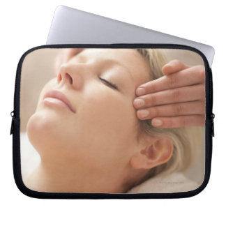MODEL RELEASED. Facial. Computer Sleeve