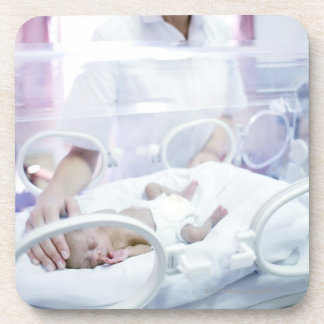 MODEL RELEASED. Nurse and premature baby. Drink Coasters
