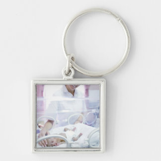 MODEL RELEASED. Nurse and premature baby. Key Chains