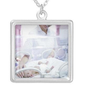 MODEL RELEASED. Nurse and premature baby. Square Pendant Necklace