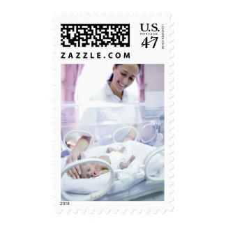 MODEL RELEASED. Nurse and premature baby. Postage