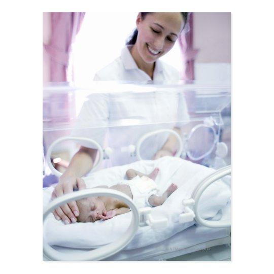 MODEL RELEASED. Nurse and premature baby. Postcard