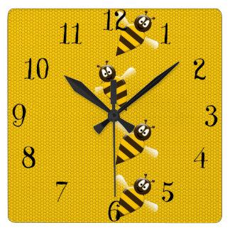 Modelo abstracto amarillo lindo de las abejas de l reloj cuadrado