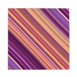 Modelo abstracto colorido de las rayas posavasos de madera