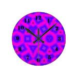 Modelo abstracto multicolor y de las formas reloj de pared