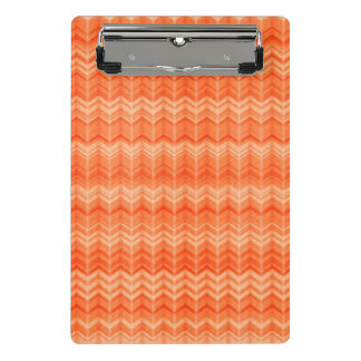 Modelo abstracto rojo de la materia textil del minicarpeta de pinza