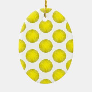 Modelo amarillo de la pelota de golf adorno navideño ovalado de cerámica