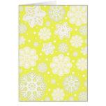 Modelo amarillo del copo de nieve del navidad tarjeta