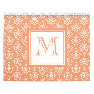 Modelo anaranjado 1 del damasco con el monograma calendario
