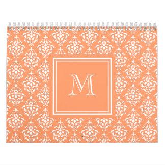 Modelo anaranjado 1 del damasco con el monograma calendarios