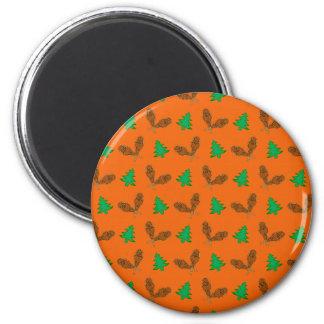 Modelo anaranjado de la raqueta iman de nevera