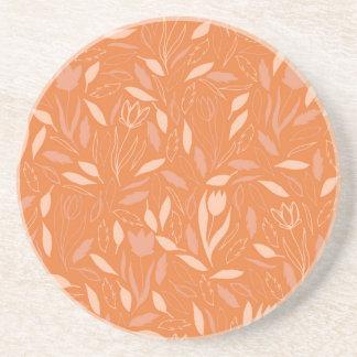 Modelo anaranjado de las flores y de las hojas posavasos personalizados