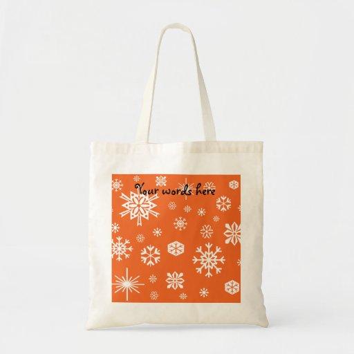 Modelo anaranjado de los copos de nieve bolsa de mano