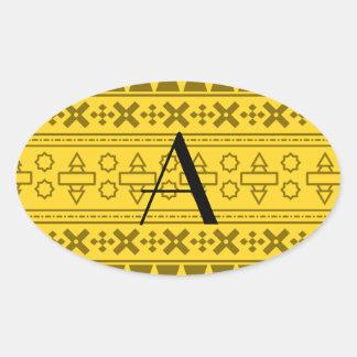 Modelo azteca amarillo del monograma colcomanias ovaladas