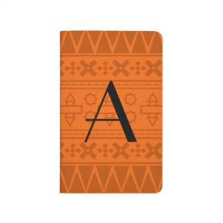 Modelo azteca anaranjado del monograma cuadernos