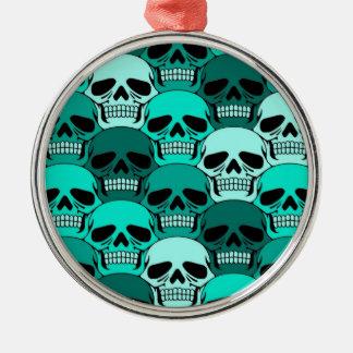 Modelo azul del cráneo del trullo que entrelaza adorno navideño redondo de metal