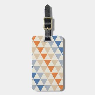 Modelo azul del triángulo del naranja que pone en etiquetas para equipaje