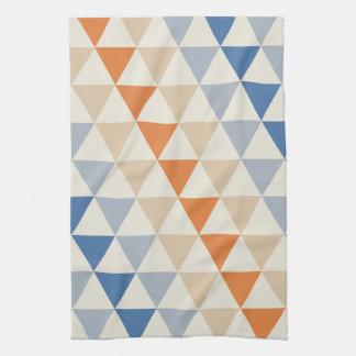 Modelo azul del triángulo del naranja que pone en toallas de cocina