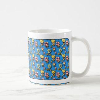 Modelo azul floral del vintage taza