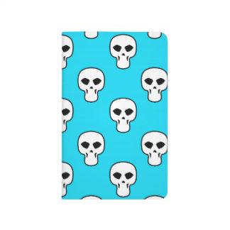 Modelo azul negro, blanco, de neón de los cráneos cuaderno