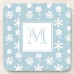 Modelo azul y blanco 1 de los copos de nieve con e posavaso
