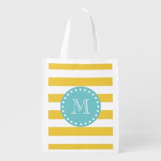 Modelo blanco amarillo de las rayas, su monograma bolsa de la compra
