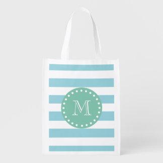 Modelo blanco azul de las rayas, monograma de la v bolsa reutilizable
