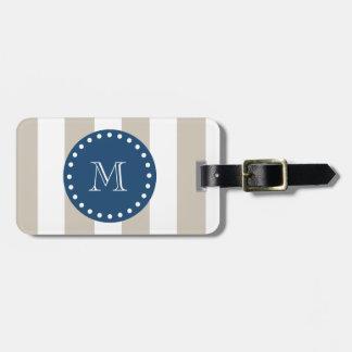 Modelo blanco beige de las rayas, monograma de los etiqueta de equipaje
