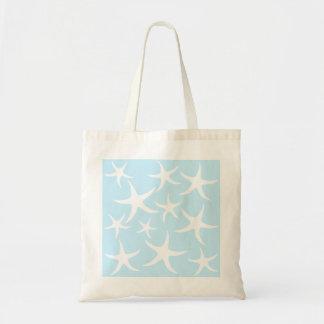 Modelo blanco de las estrellas de mar en azul clar bolsas