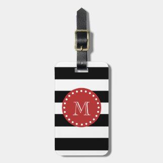 Modelo blanco negro de las rayas, monograma rojo etiqueta de maleta