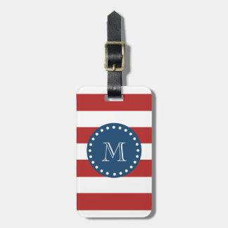 Modelo blanco rojo de las rayas, monograma de los  etiqueta de equipaje