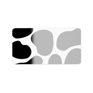 Modelo blanco y negro de la impresión de la vaca etiqueta de dirección