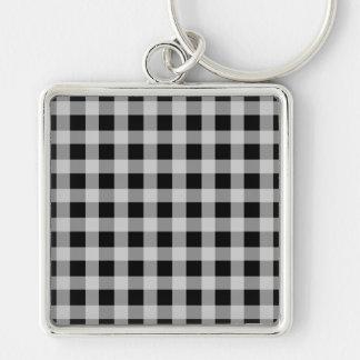 Modelo blanco y negro de la tela escocesa del llavero cuadrado plateado