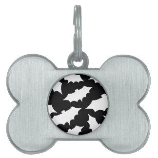 Modelo blanco y negro del palo placas de mascota