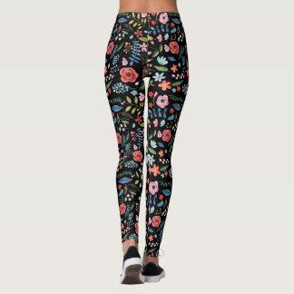 Modelo botánico colorido de las flores y de las leggings