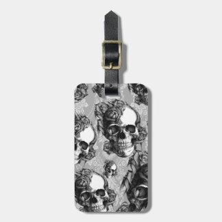 Modelo color de rosa blanco y negro del cráneo ma etiqueta para maleta