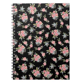 Modelo color de rosa floral del negro y del rosa libretas
