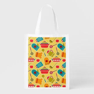 Modelo colorido de los utensilios de la cocina bolsa para la compra