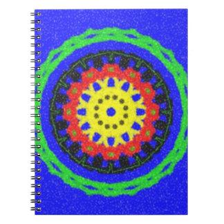 Modelo colorido del círculo en fondo azul spiral notebooks