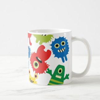 Modelo colorido divertido lindo de los monstruos taza de café