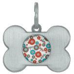 Modelo colorido retro de la libélula de la flor placas mascota
