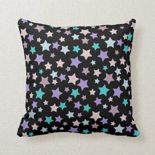 Modelo de estrella púrpura y azul en negro almohada