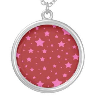 Modelo de estrellas rojo y rosado colgante redondo