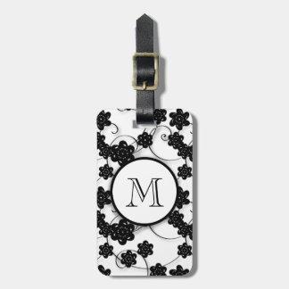 Modelo de flores negro lindo de la MOD, su inicial Etiquetas Maleta