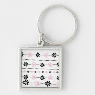 Modelo de flores rosado y negro llavero cuadrado plateado