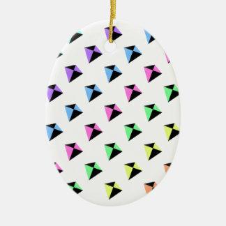 Modelo de la cometa de los colores en colores adorno navideño ovalado de cerámica
